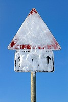 A traffic sign, snow covered