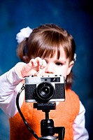 Little Girl with an old-fashioned camera