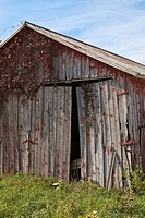 Decaying barn along a gravel road in the Midwest