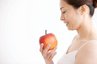 Mature Woman Having Apple