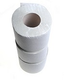Three rolls of simple grey toilet paper made of waste paper