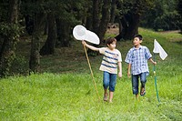Boys walking with butterfly nets, Chiba Prefecture, Honshu, Japan
