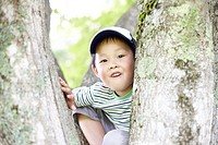 Portrait of Boy Climbing Tree