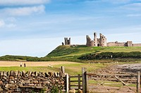 Dunstanburgh castle ruins in Northumberland, England