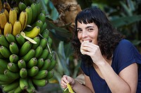 Woman eating fresh banana