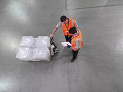 Workers with pallet truck