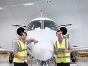 Engineers with jet aircraft