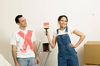 Woman showing off paint on mans shirt