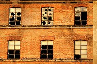 Broken windows on the old factory facade, Kempten, Bavaria, Germany, Europe