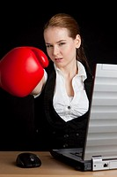businesswoman with a notebook and boxing glove