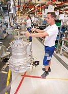 Operators working in the production of gearboxes for the automotive industry at the ZF Friedrichshafen AG, an automotive supplier, Friedrichshafen, Ba...