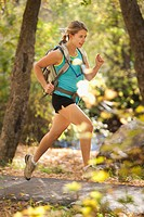 USA, Utah, young woman enjoying cross_country running