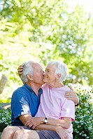 Senior man kissing wife on cheek