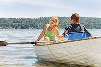 Boy and girl in row boat