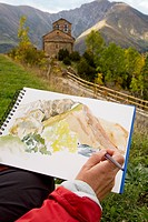 Man painting a watercolor  Chapel of Sant Quirze  Durro  Boi - Taull Valley. Alta Ribagorça, Lleida province, Catalonia, Spain