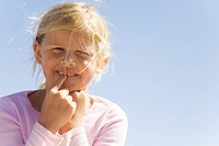 Girl pointing to new tooth