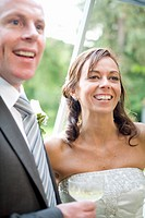 Newlywed couple smiling and holding a champagne flute, East Meredith, New York State, USA
