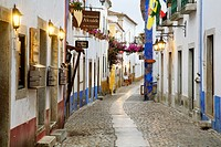 Portugal, Estremadura, Obidos. Alleyway in old town.
