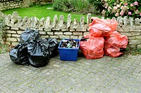 Domestic rubbish and recyling waiting for collection, England, UK