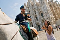 Italy, Lombardy, Milan, Duomo Square, Traffic Policeman on Horseback with Tourist