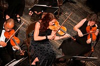 Overhead view of violinists performing in classical orchestra