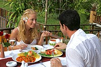 couple in love enjoying thaifood at restaurant in Railay Princess Ressort