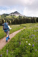 Hispanic woman hiking near mountain