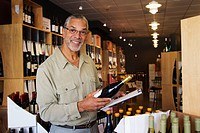 African American small business owner working in wine shop