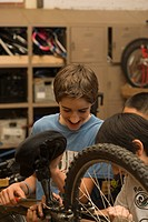 Children repairing bicycle