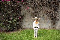 A boy dressed as a Mexican charro pose for a picture in Mexico City, August 17, 2008  Male rodeo competitors are 'Charros,' from which comes the word ...