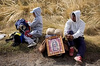 Pilgrims rest in a field as they travel to reach the Basilica of Guadalupe in Mexico City, December 7, 2008  Hundreds of thousands of Mexican pilgrims...