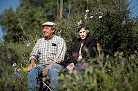 An elderly couple sit during a romeria, or pilgrimage, in honor of San Isidro Labrador, the patron of farmers, in Prado del Rey village, Cadiz Provinc...