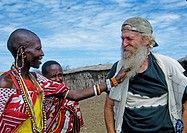 Kenya, Masai Mara National Wildlife Reserve. Two women in Masai Mara village curious about visitor´s beard. Credit: Joanne Williams / Jaynes Gallery /...