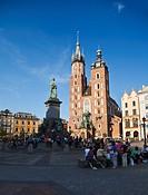 Krakow landmarks - Basilica of Virgin Mary on Main Market Square and Adam Mickiewicz Monument