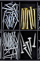 Screws and nails in accessory box or compartments of tool box
