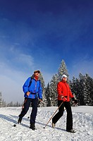 Hikers walking along Germany's first premium winter hiking track, Hemmersuppenalm, Reit im Winkl, Bavaria, Germany, Europe