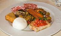 Italy, Naples. Plate with variety of antipasti appetizers. Credit: Wendy Kaveney / Jaynes Gallery / DanitaDelimont.com