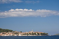 Croatia, Dalmatia, Korcula Island, Korcula town. View of town from Adriatic Sea. Town is perched on a peninsula, surrounded by 13th century walls.