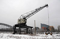 Historic crane on the snowy bank of the Main River, historic Weseler Werft wharf, Frankfurt am Main, Hesse, Germany, Europe