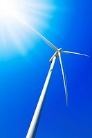 Wind turbine under clear blue sky