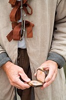 Elderly man teaches visitors how sailors who sailed from England to Virginia in 1607 measured distance at sea, Jamestown Settlement, Jamestown, Virgin...