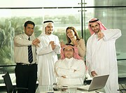 Small group of business persons showing hand gestures