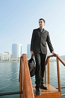 Young Businessman standing on the bridge.