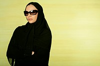 Arab lady wearing eyeglasses looking at the camera.