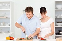 Lovers cooking together in the kitchen at home