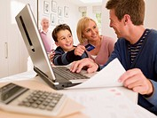 Family shopping online with credit card