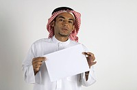 Young Arab man showing a paper