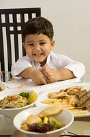 Young Boy eating at the dining table