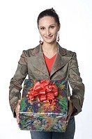 Young woman holding gift box, portrait