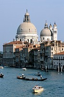 Gondola and boats on the Grand Canal in front of Santa Maria della Salute church. Venice, Italy